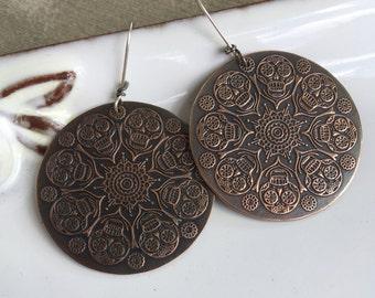 Copper skull earrings on sterling silver ear wires