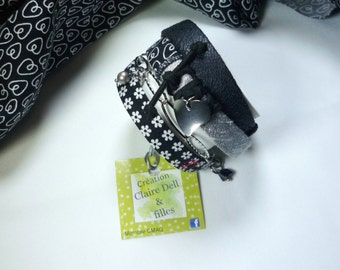 Textile, multi-stranded bracelet that wraps around the wrist and made two bracelet in one!