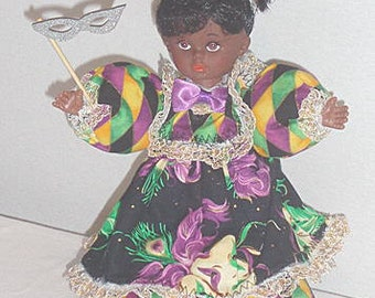 Gaynall, African American vinyl doll, dressed for Mardi Gras