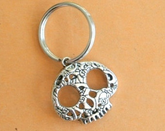 The SKULL Keychain..silver. antique silver charm. skeleton. hand. retro. kitsch. boho. metal. urban. hipster. hippie. creepy. skull. head