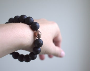 black and rose gold bracelet with matte onyx faceted stones. rose gold vermeil geometric focal bead. minimal. urban. chic.