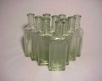 Group of Ten c1890s 1 1/2 Oz. Pale Aqua Blown Glass Medicine Extract bottles No. 5