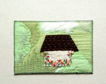 White farmhouse with flowers textile postcard, embroidered Fiber Art Card, white green, red pink flowers, Polish folk art , modern rustic