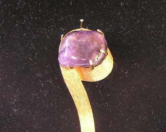 Gold metal and Amethyst brooch