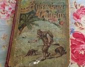 An Antique Copy Of Robinson Crusoe Its Been In An Adventure Too