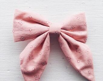 Pink with diamonds.