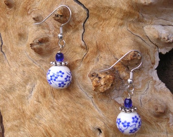 five dollar earrings, hypo allergenic earrings, white ceramic beads, blue flower beads, boho, Montana, dangle earrings, blue glass earrings