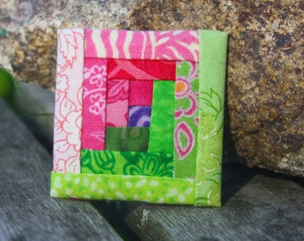 Hand-pieced lapel pin: Green and Pink