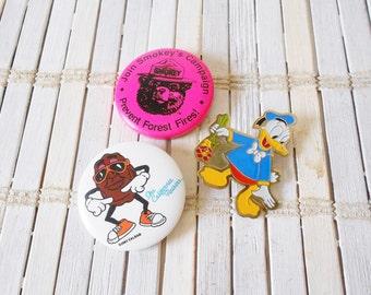 Retro Pins Lot of 3, Donald Duck, California Raisin, Smokey the Bear, Neon pink, Pop art style, kitschy, pinback buttons, Flash, Cartoon pin