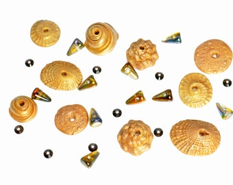 A Collection of Metallic Bronze/Gold Polymer Clay Seashells, Swarovski Lochrosen, and Czech glass Baby Spike Components