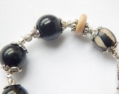 Charm Bracelet  With Black And White Agate And Dagger