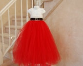 Holiday Santa dress with luxurious rhinestone Buckle. Red Tulle and white crochet top. Black ribbon belt and lace straps..