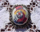 Vintage Brooch with Sad Faced Clown on Antiqued Gold Tone Filigree Cameo Brooch