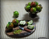 Miniature dollhouse apples being cut and peeled on a prep board, dollhouse 12th scale miniature food