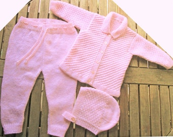 Baby infant girl hand knitted pale pink matinee outfit of jacket / cardigan trousers / leggings bonnet / hat pram set.