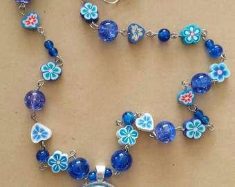 Sale was 24 now 21uk Blue Forget Me Not Floral Faux Mille Fiori Pendant on bead and Flower bead Necklace.