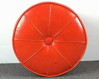 Orange Mid Century round ottoman hassock