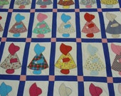 Quilt/Comforter: Sunbonnet Sue quilt/summer blanket 1960's featuring  scrappy color coordinated cotton Sues, blue sashing & pink squares