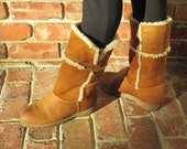 Womens size 7.5 Suede and Leather Cougar Fleece Lined Winter Boots