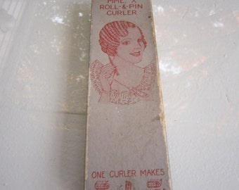 Vintage bakelite curler set in original box