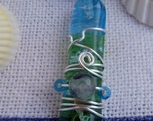 """Translucent blue and green glass fusion wire wrapped pendant with 20"""" ribbon necklace"""