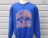 Late 80's, early 90's St. Louis Blues sweatshirt, fits like a roomy medium