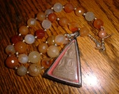 Sacred Buddha Tablet Necklace on Faceted Amber Beads