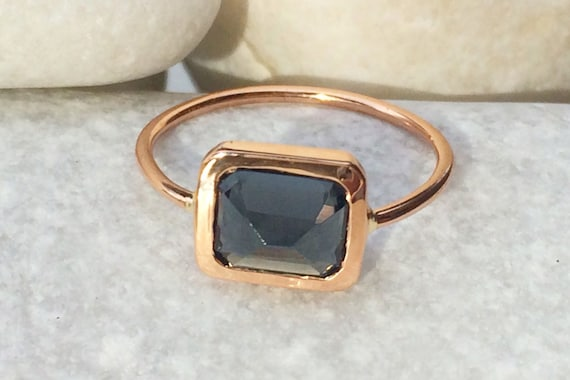 Untreated grey spinel and solid 14k rose gold ring