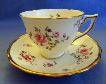 """VINTAGE Teacup & Saucer - Bone China, Scattered clusters of Pink Roses and tiny lavender flowers, Gold trim, """"Melba"""" - """"Made In England"""""""