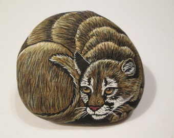 Cougar hand painted on a stone - pet rock - by Ann Kelly