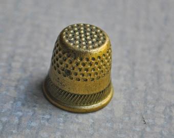 Vintage brass thimble.