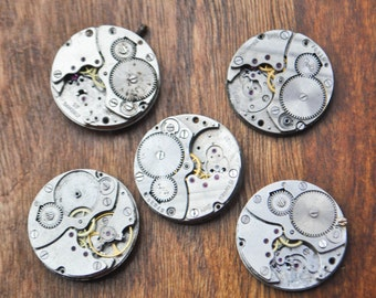 0.9 inch Set of 5 vintage watch movements.