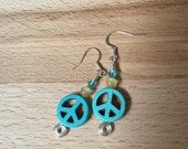 Turquoise peace sign bead earrings with cat eye and blue crystal bead