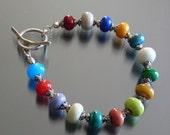 Handmade artisan lampwork bead glass bracelet by fire forged studio