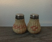 Vintage French wicker and glass salt and pepper shakers