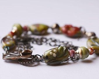 my Mother's garden..Artisan made bracelet Murano glass beads fabricated clasp