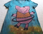 An adorable pig with a hula hoop, silk screened flowers, dyed and discharged woman's large v-neck t-shirt, turquoise, pink, and orange