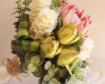 Tropical Nellie - Bride's bouquet. Tropical ginger flowers, proteas, babies breath, geraldton wax, native and tropical foliage..