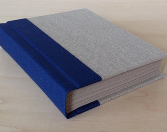 Traditional hard bound blank journal or sketchbook with linen and navy blue book cloth cover with blank pages