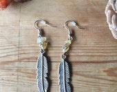 Bohemian silver tone yellow dangle feather earrings