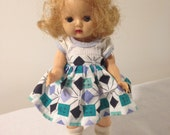 """1950s 7 1/2"""" hard plastic Walker Doll with Open and Close Eyes and Stylish Wardrobe"""