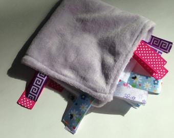 Purple taggie blanket