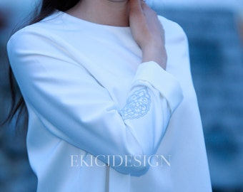Asymmetric blouse with artful embroidery on sleeve