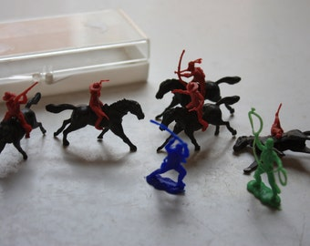 Tiny vintage plastic cowboys and indian toys