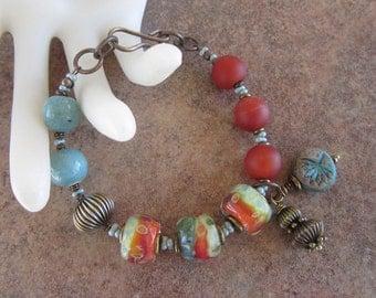 Chunky Asymmetrical Teal Green and Orange Lampwork, Matte Terra-Cotta Rust Carnelian Gemstones, and Teal Blue Ceramic Beads Brass Bracelet