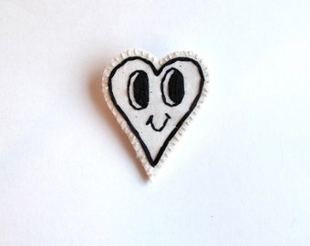 Valentines day brooch hand embroidered heart with smily face in black and white kitsch jewelry An Astrid Endeavor