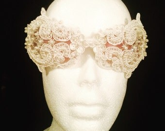 Beaded lace sunglasses in white.