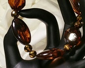 Chunky brown tortoise shell glass beads stretch bracelet, gold 6mm oval spacer beads      Free shipping USA orders only