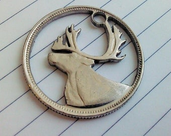 Caribou.  Cut coin charm by invicia