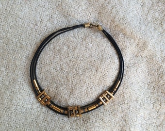 Leather and gold plated brass choker.